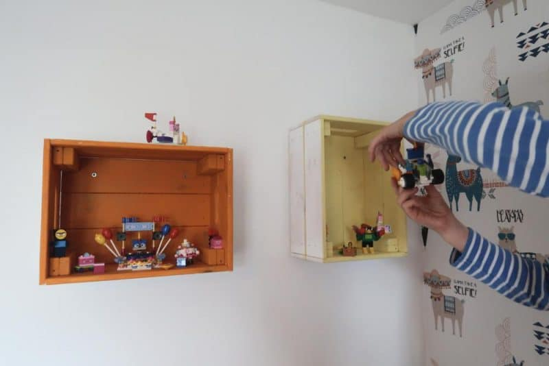 playing with lego in childrens bedroom