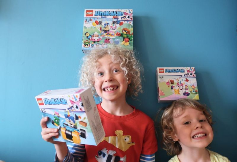 Tesco Lego Unikitty boxes balancing on kids heads