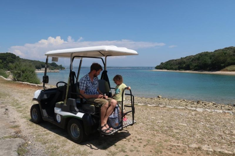 golf buggy by the sea