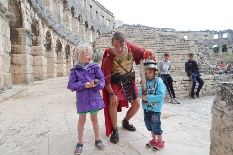 two children meeting a gladiator at Pula Arena Croatia
