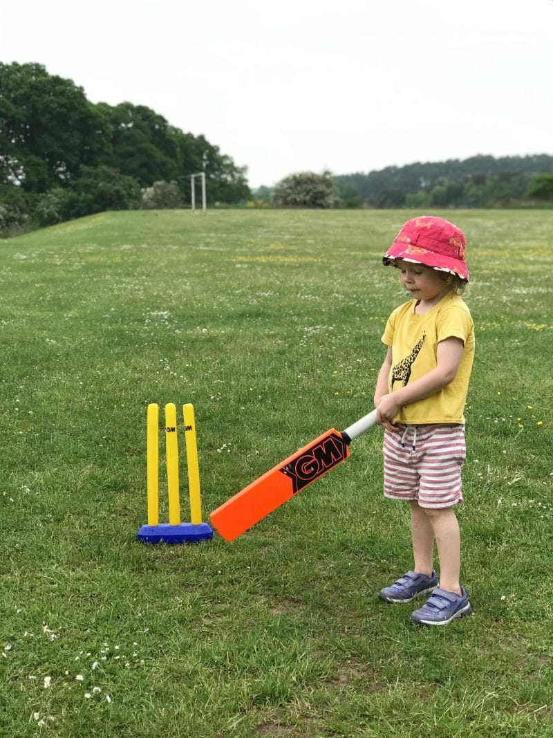 practising cricket on the grass