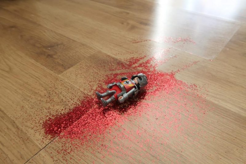 knight lying in red glitter