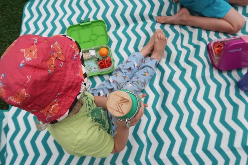 Yumbox and child holding metal bottle