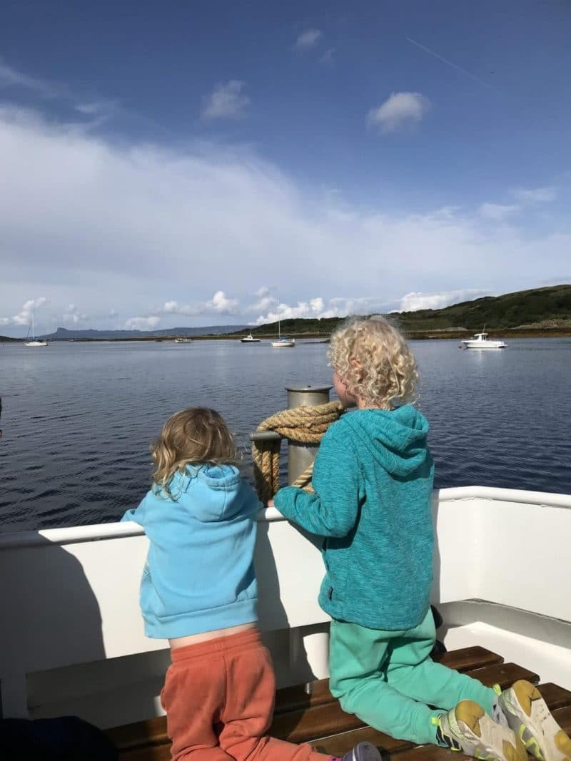 spotting whales from a boat in Scotland