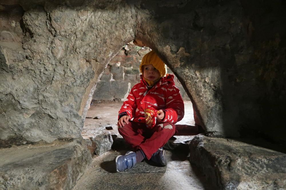 child in bread oven at castle