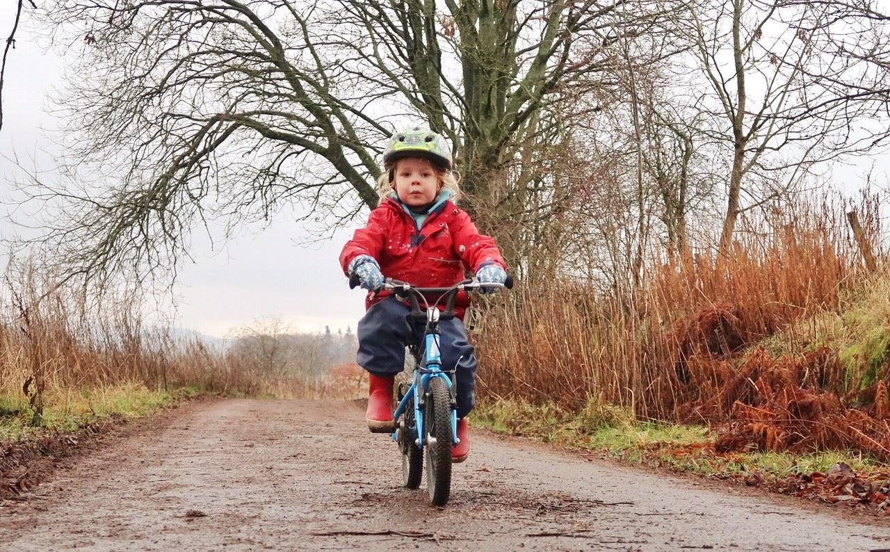 5 year old cycling a bike