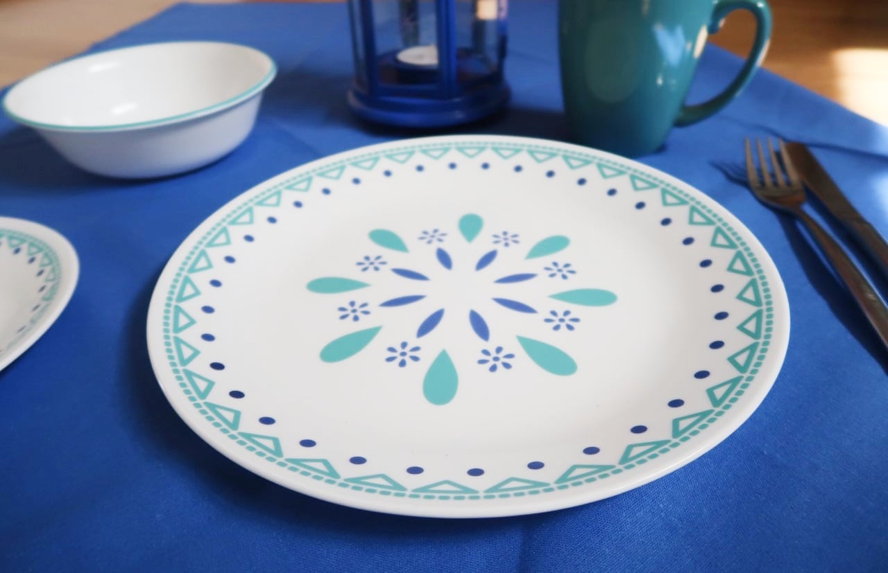 blue and white decorated corelle plate