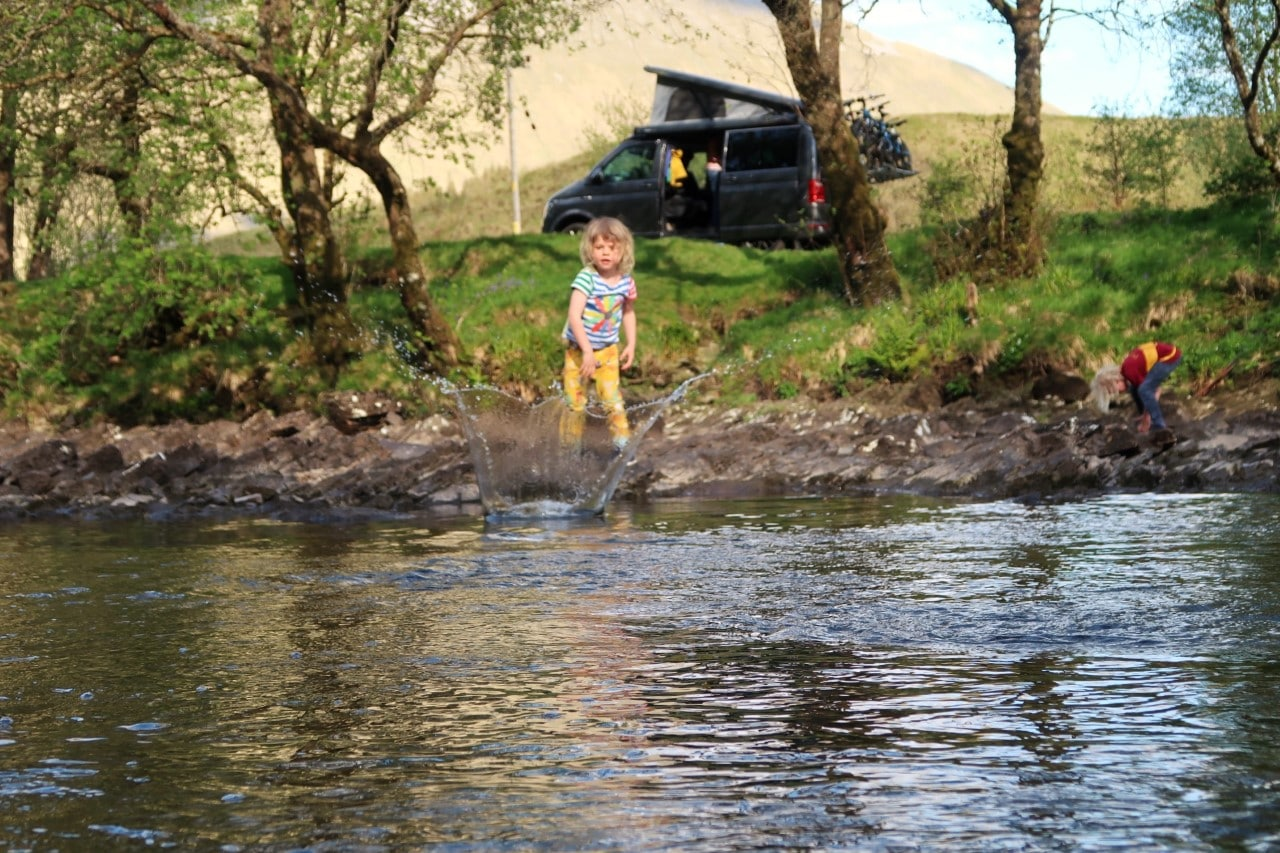 campervan and child by river