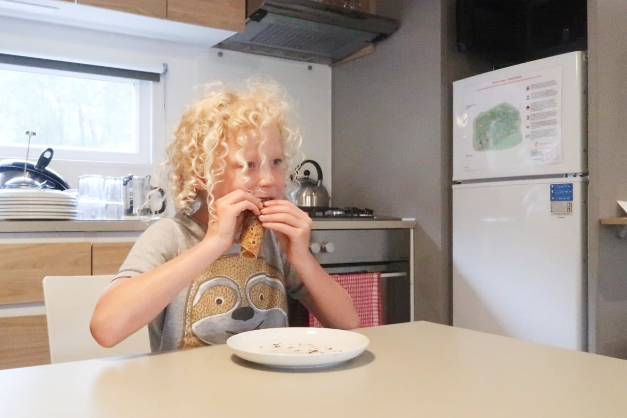 child eating crepes