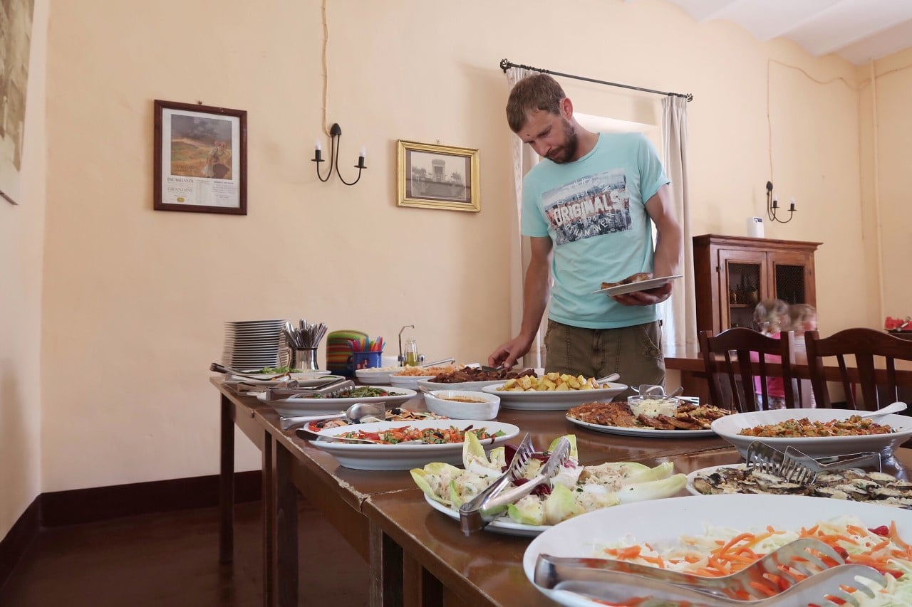 man choosing lunch from buffet