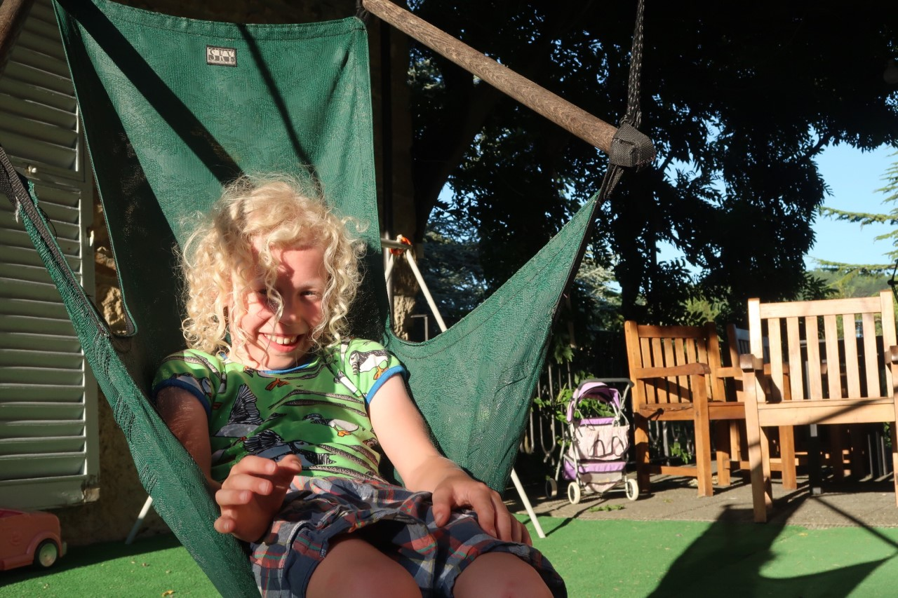 child in hammock seat