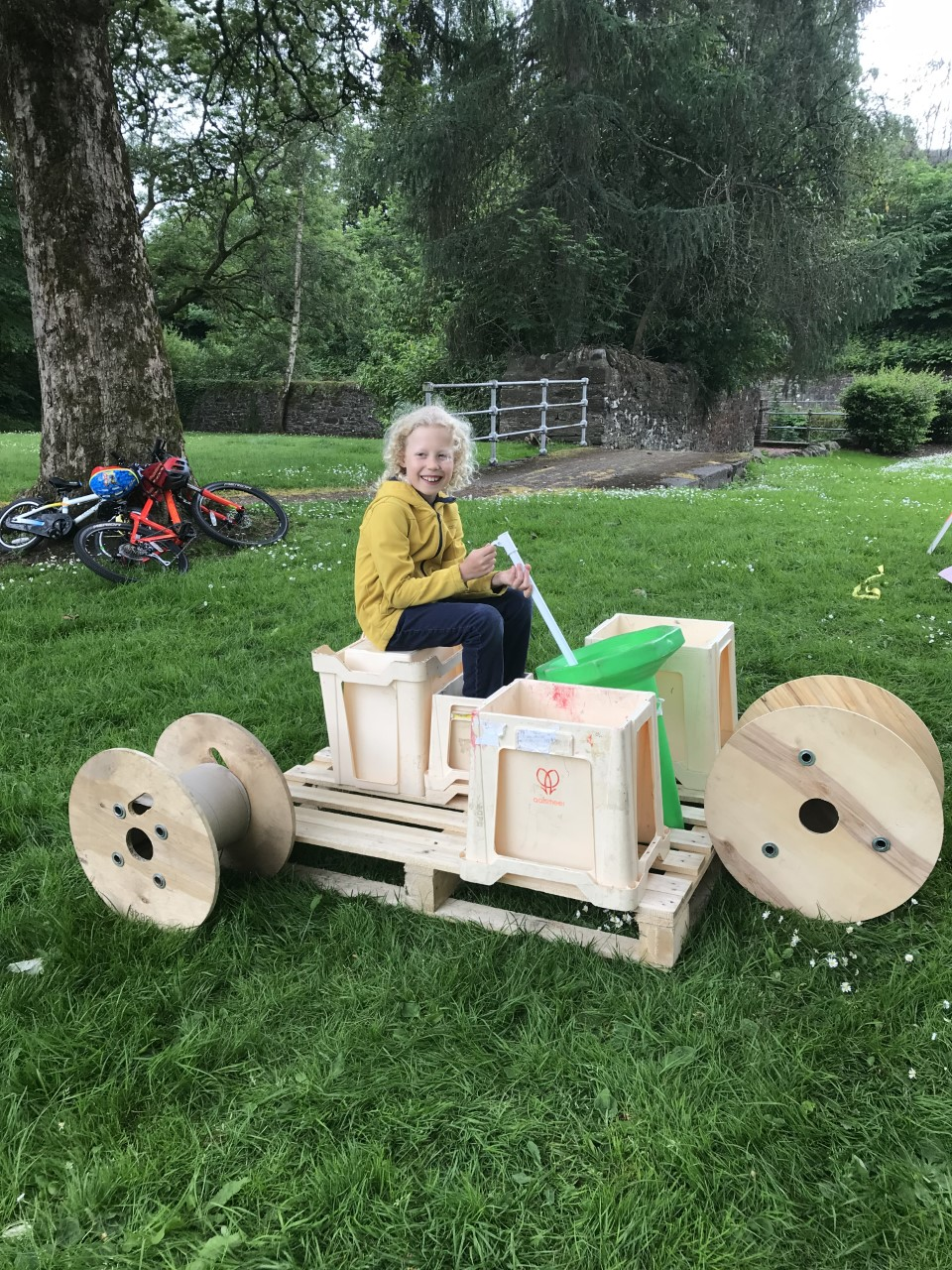 child building a vehicle out of loose parts