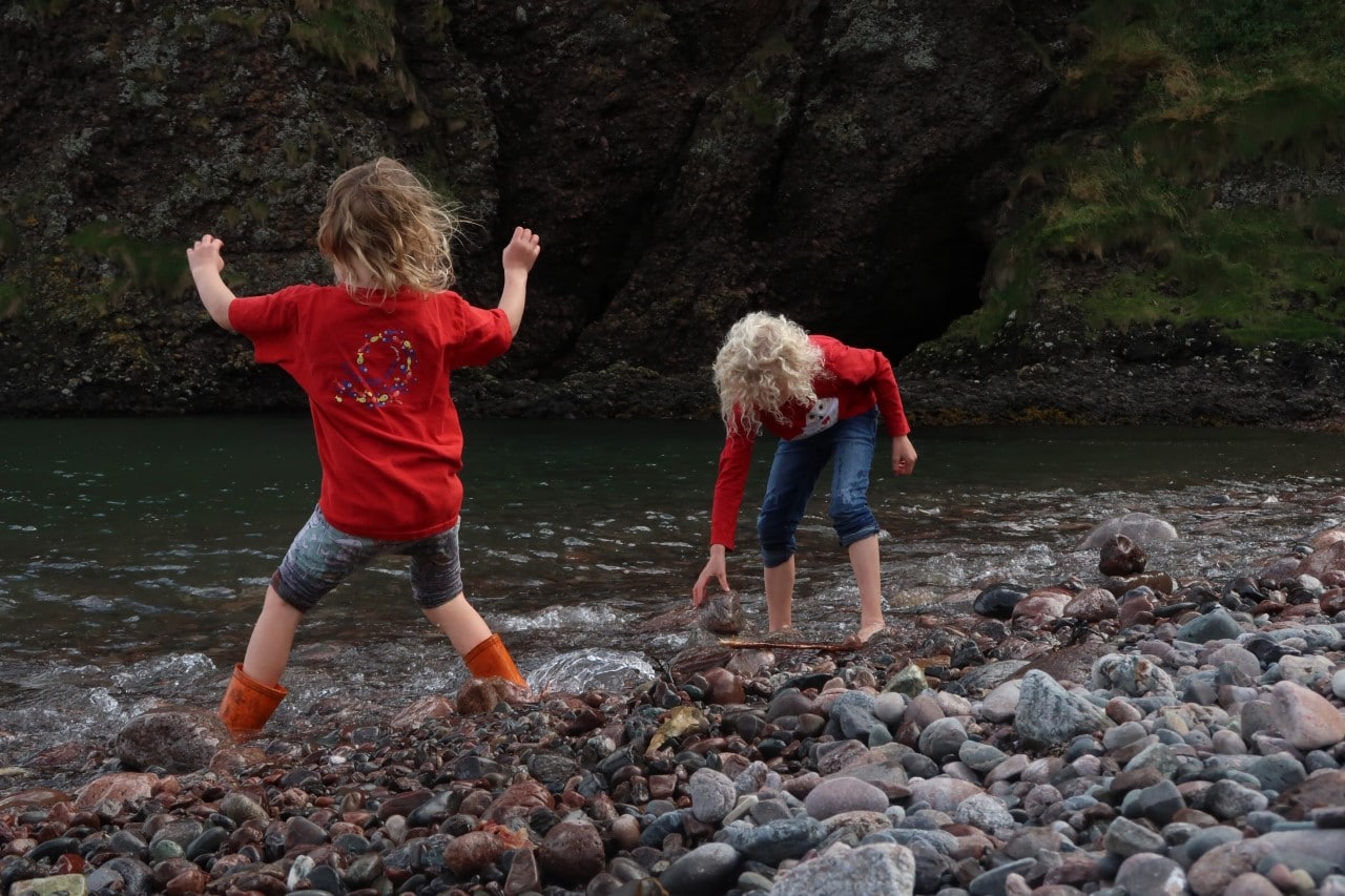 children playing at Dunnotar