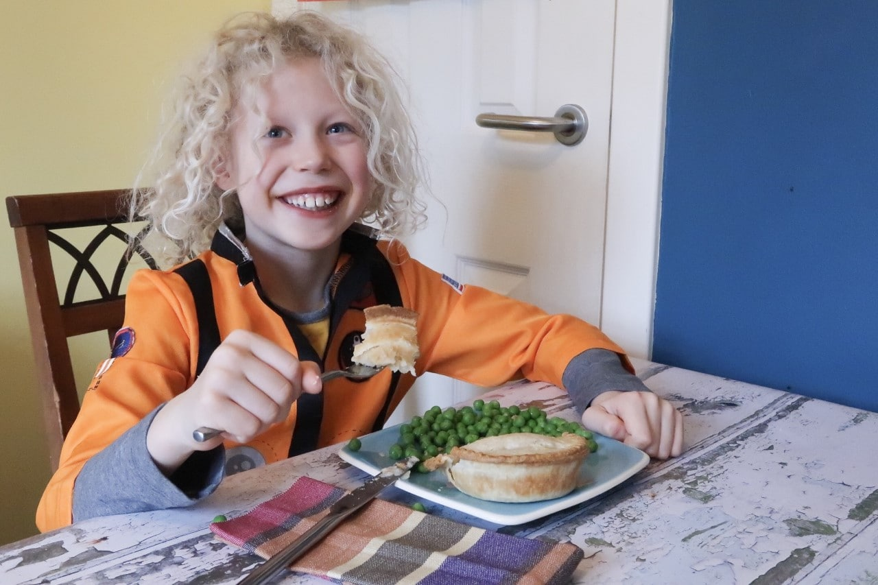 child eating a vegetarian pie