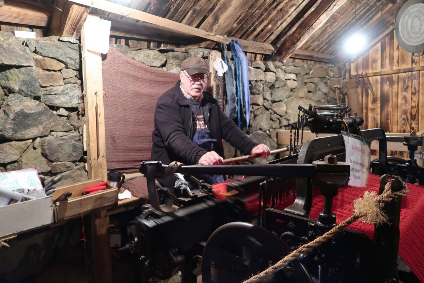 man making Harris tweed at loom