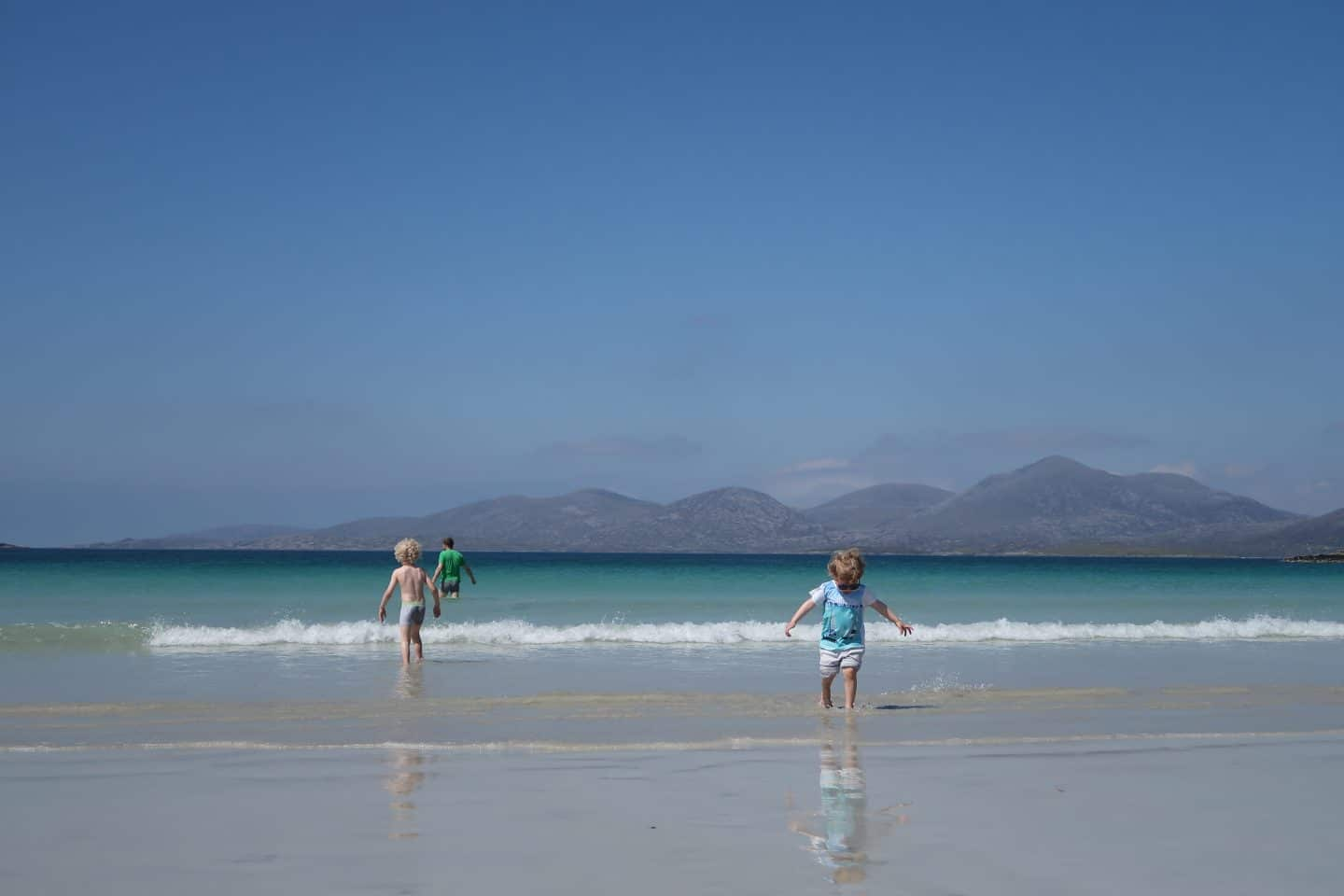 children playing on beach Harris