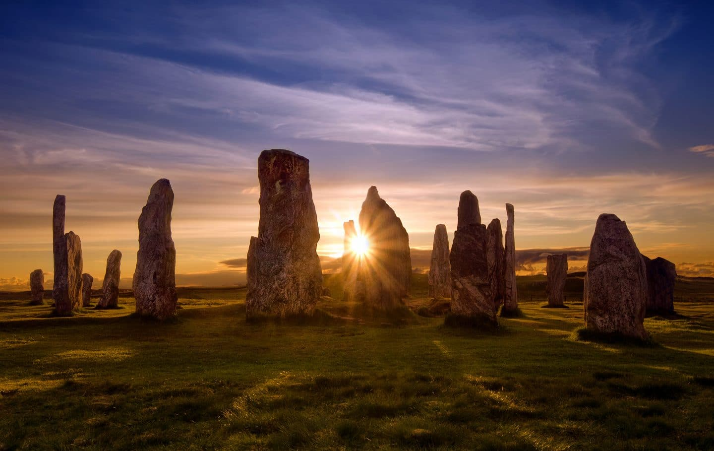 standing stones with sunset behind