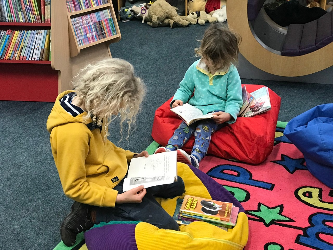 children reading at the library