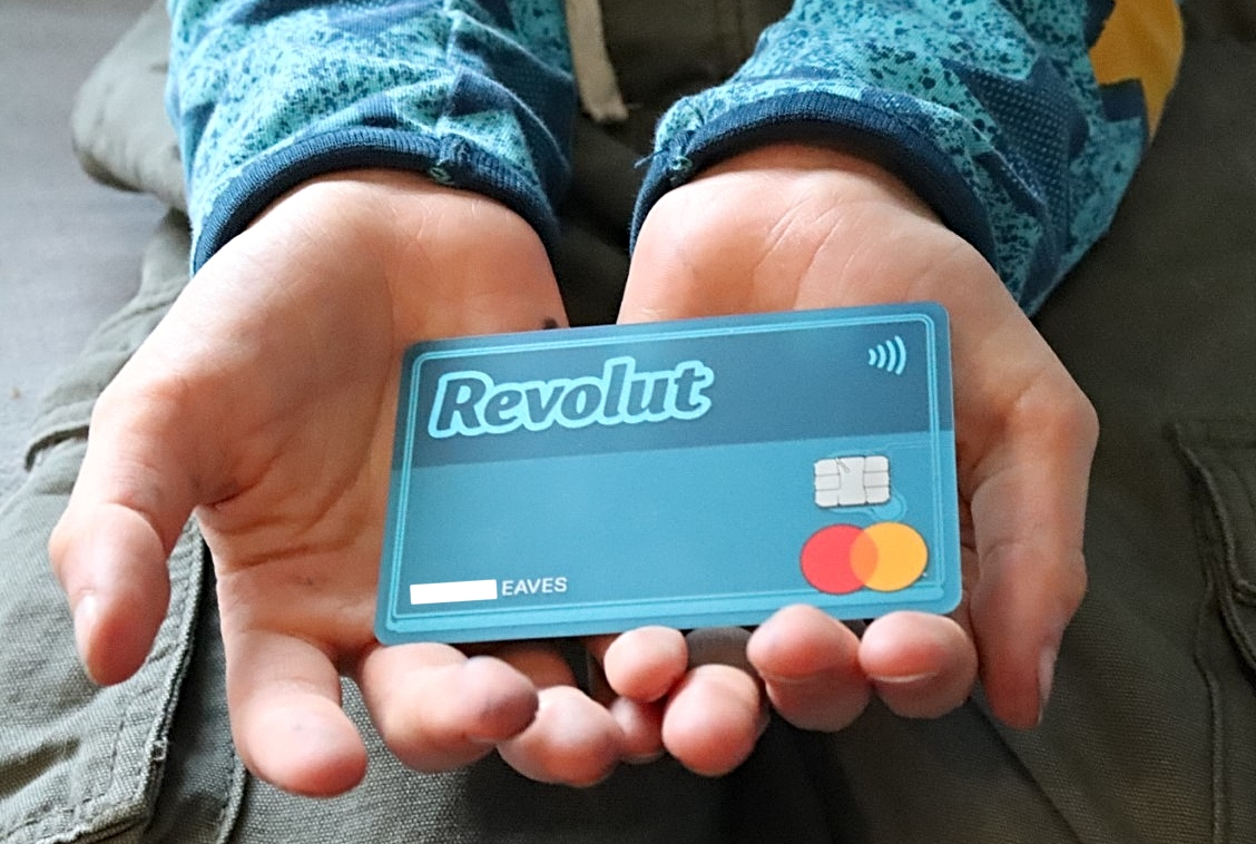 child holding their new Revolut card
