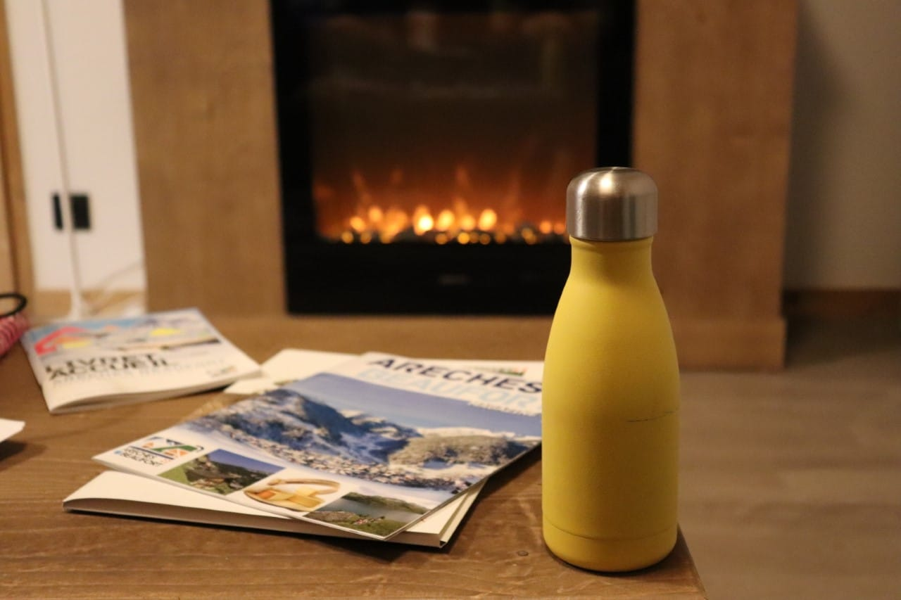 bottle and magazines at ski apartment