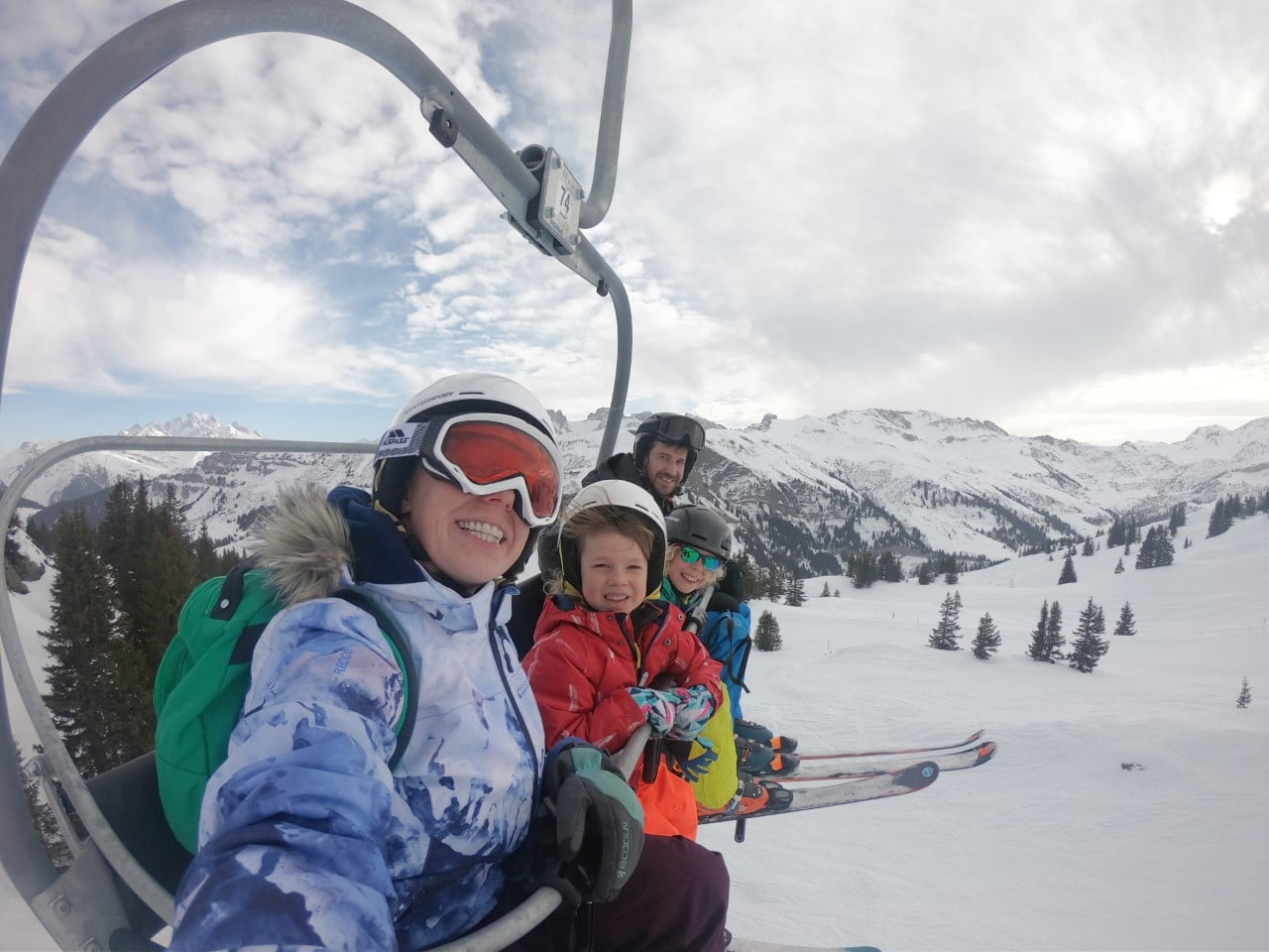 family on ski chairlift