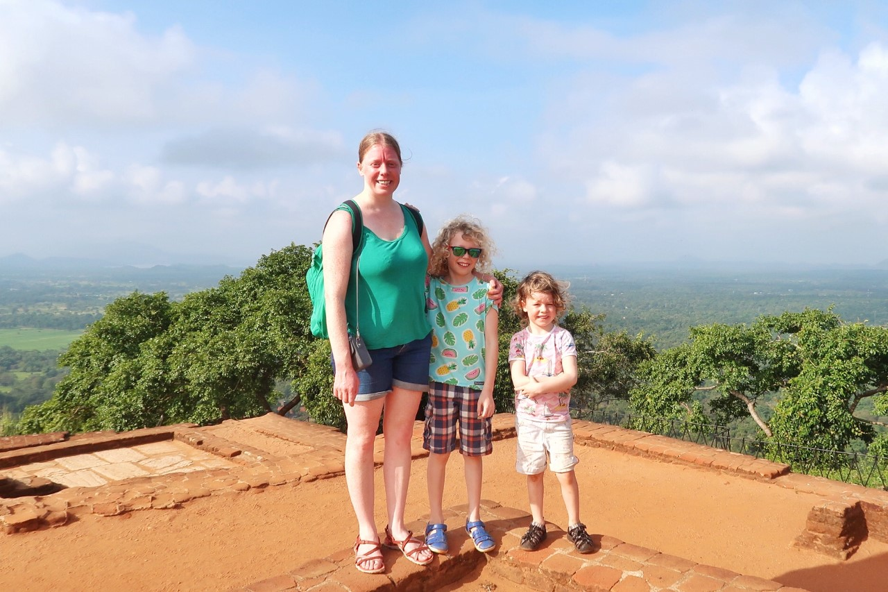 family on top of Sigiriya rock with young children