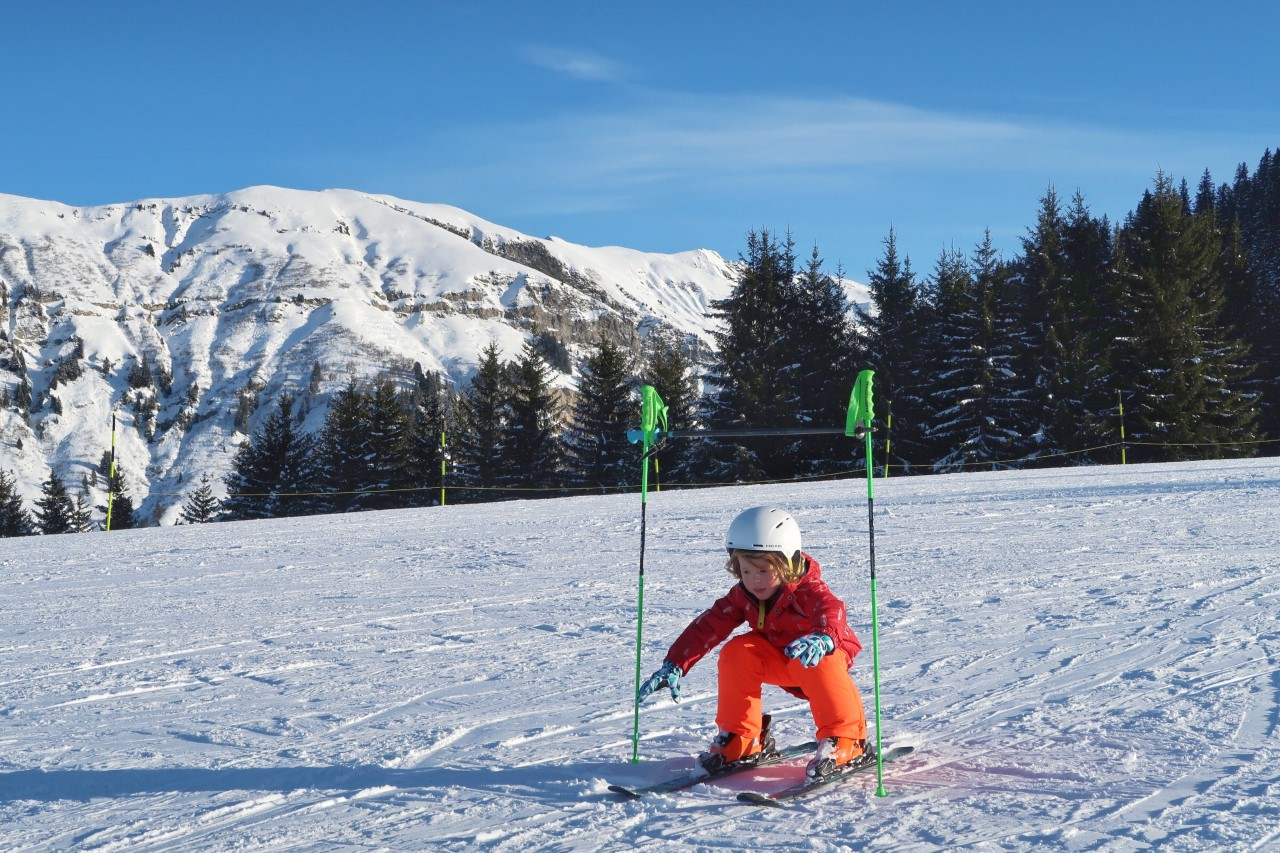 child skiing at Areches