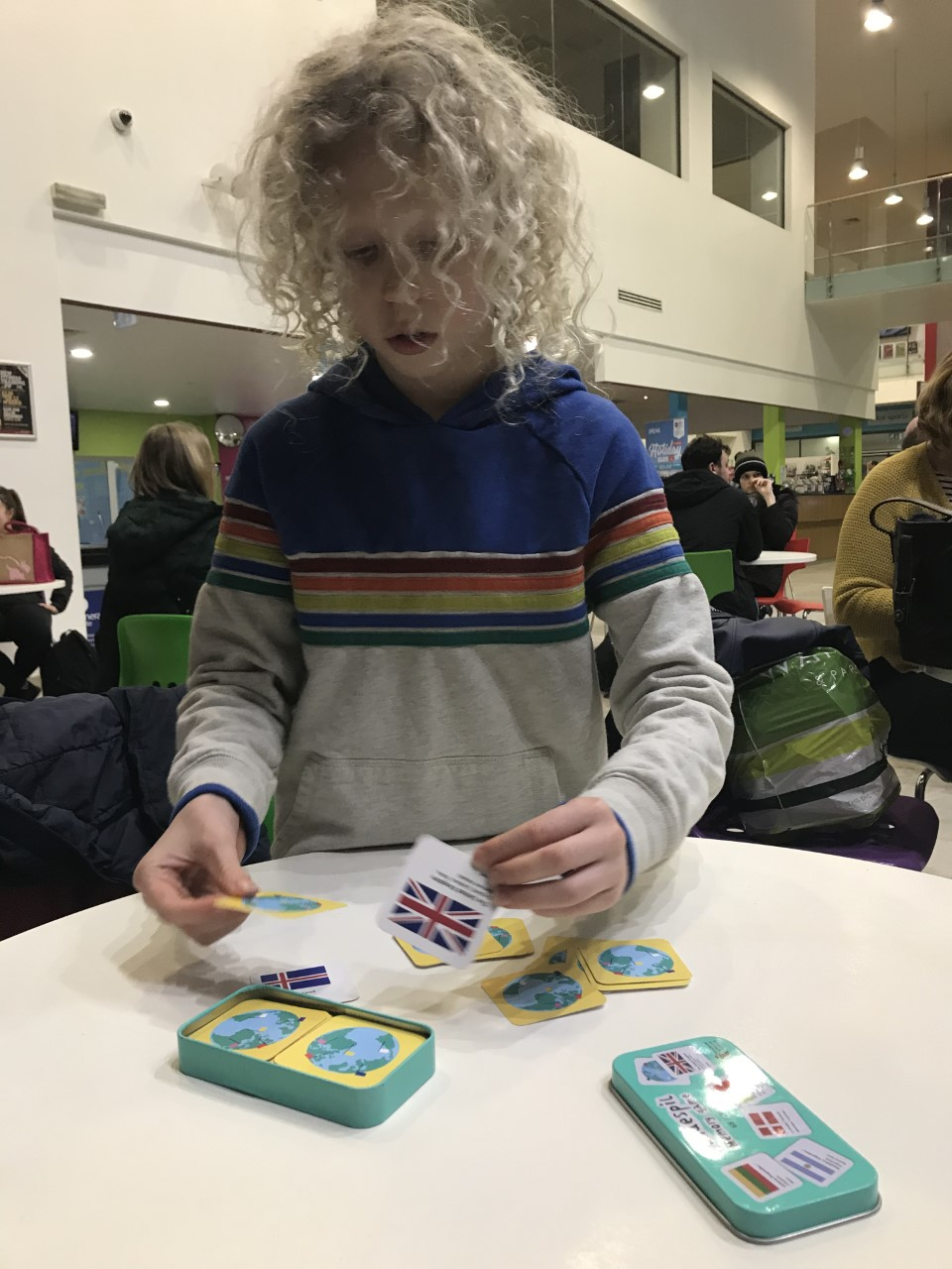 child playing map memory game