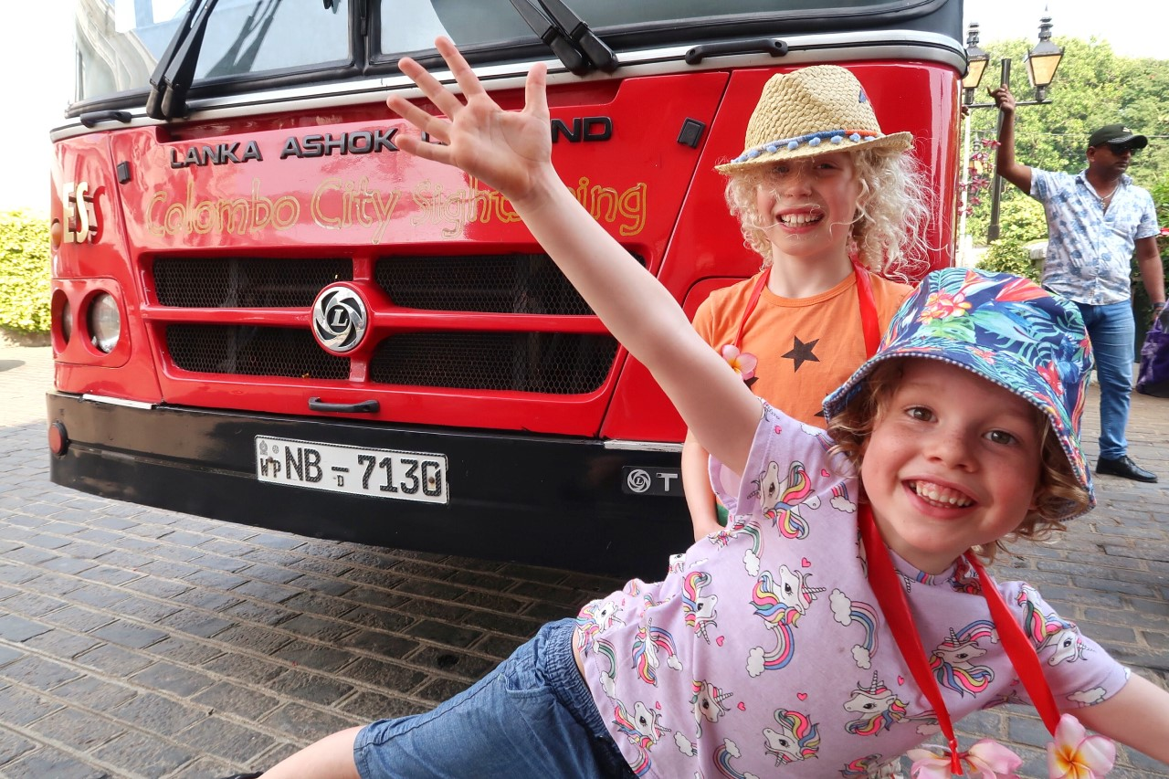 kids in front of sightseeing bus tour Colombo Sri lanka