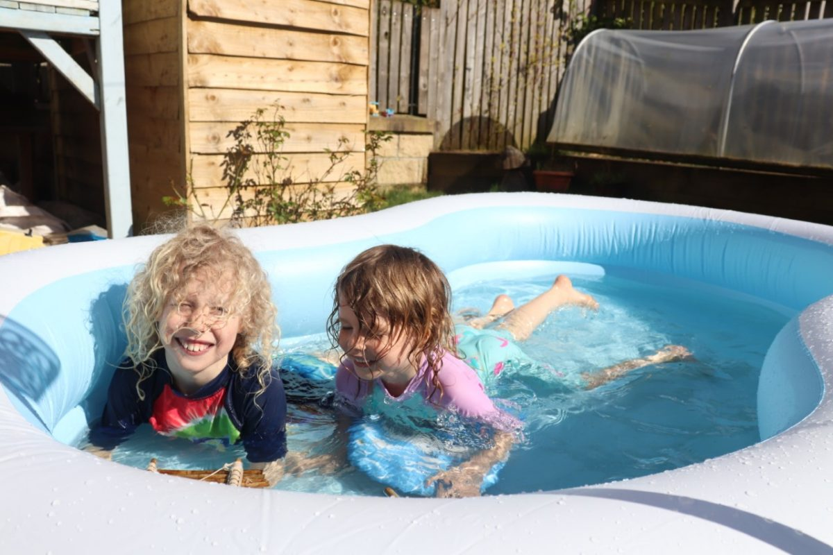 kids in paddling pool