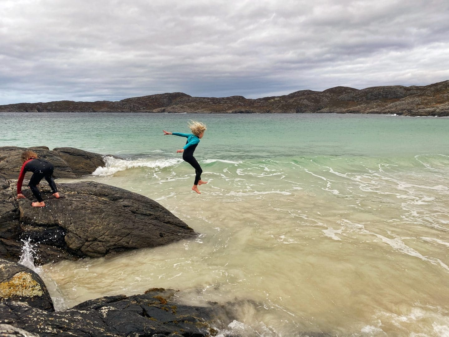 child jumping in the sea