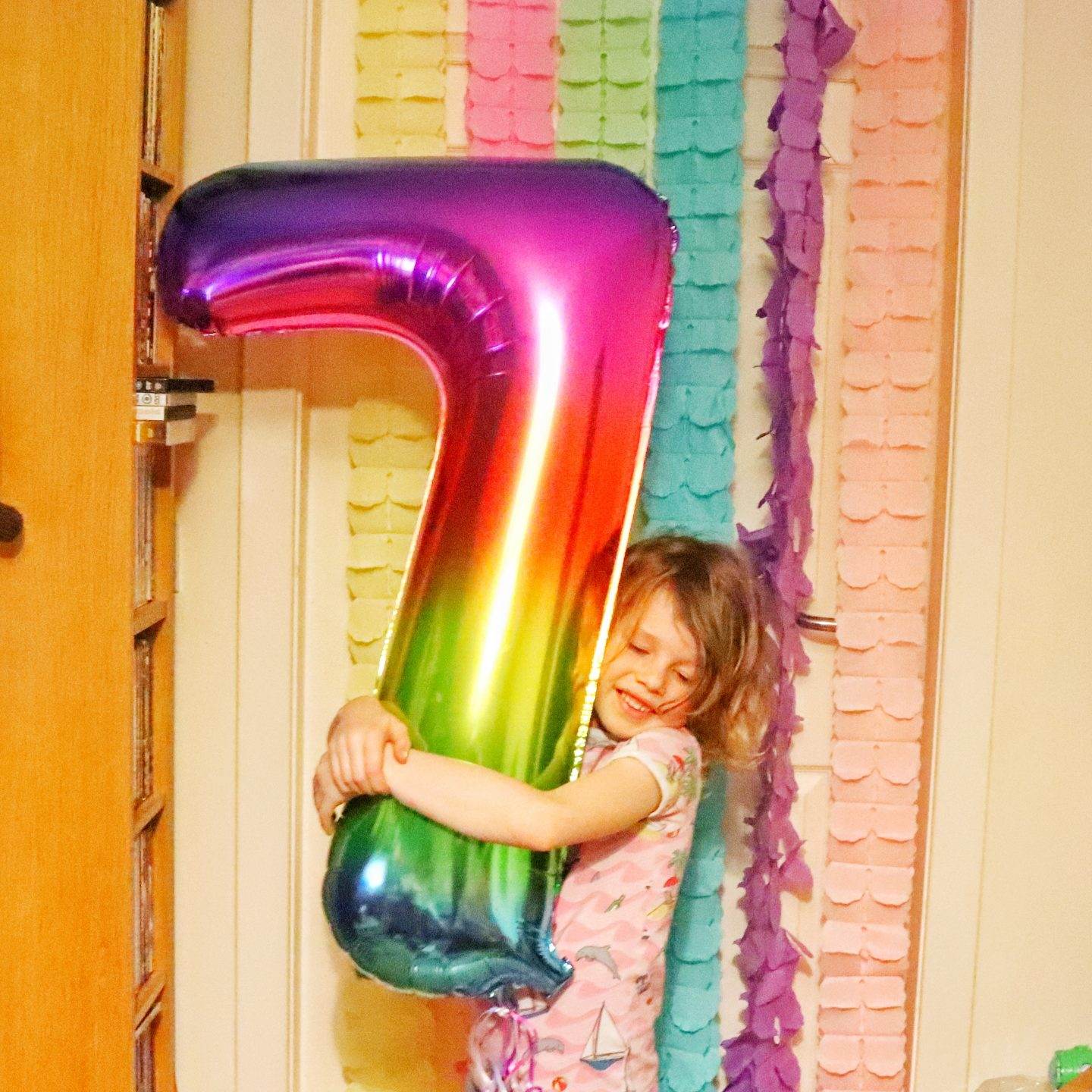 child with 7 balloon