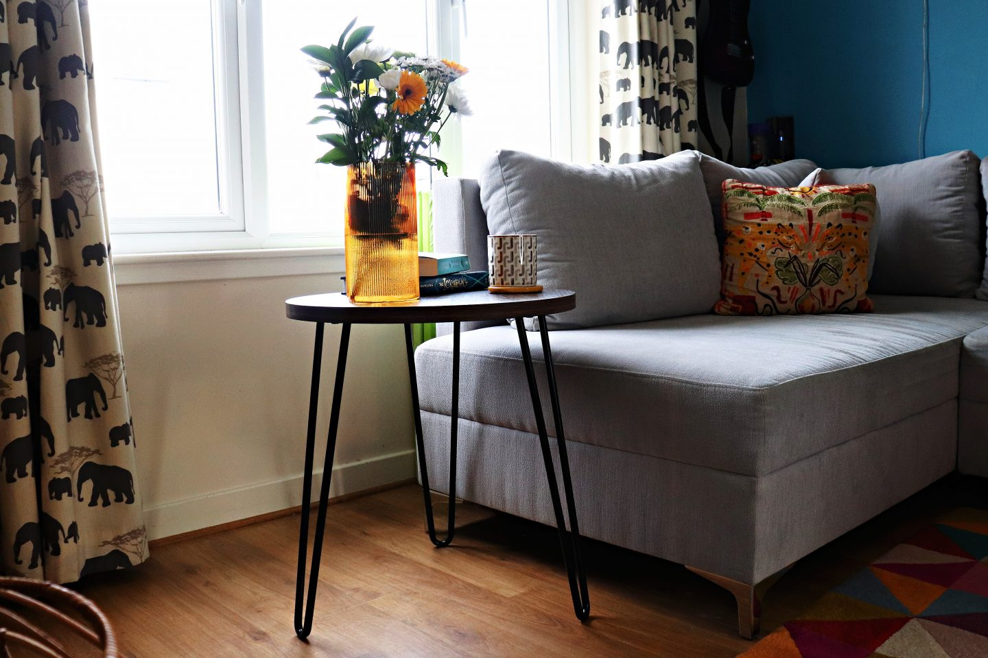 side table with vase beside sofa