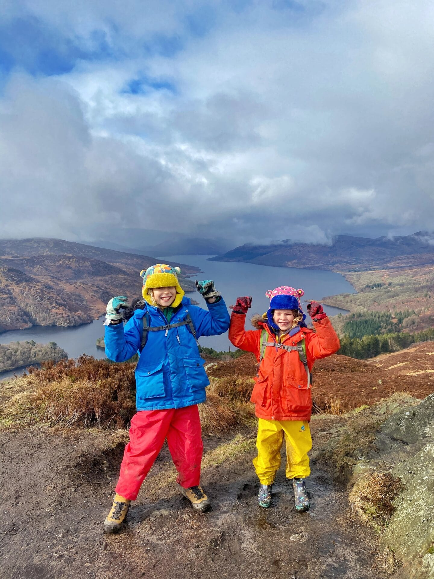 kids cheering at top of Scottish hill Ben A'an