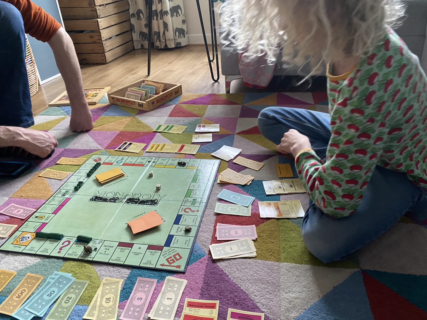 playing Monopoly on the floor