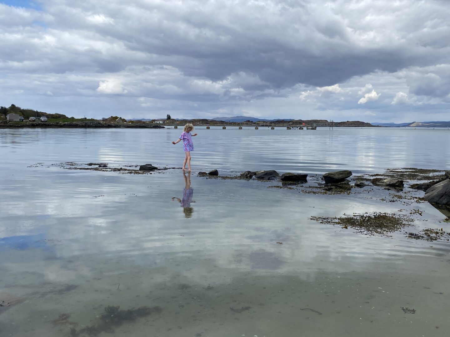 child jumping in the sea in April