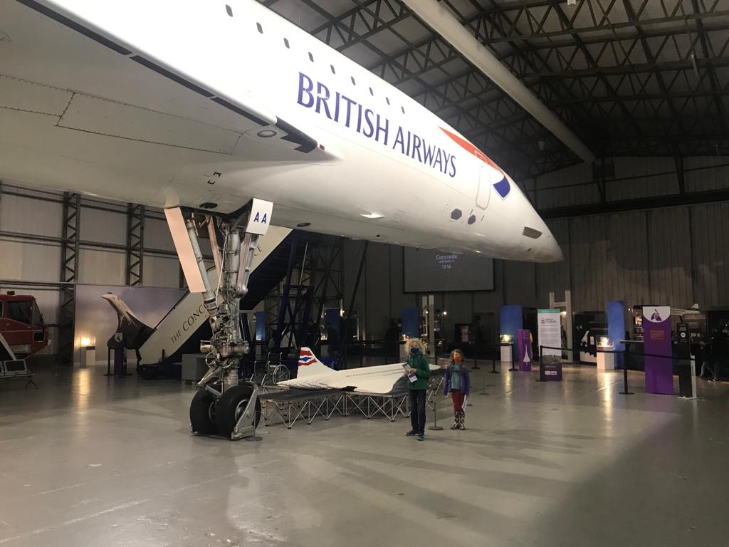 children standing under the concord at the National Museum of Flight with a Lego concord beside them