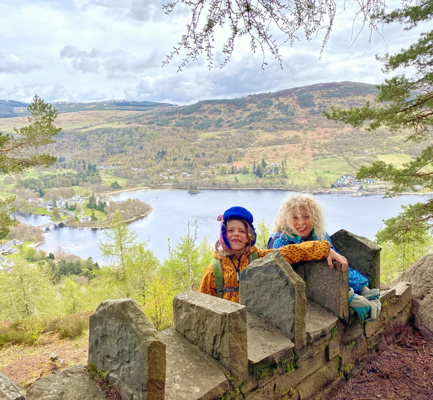 children looking over a small wall with Loch Tay down the hillside below