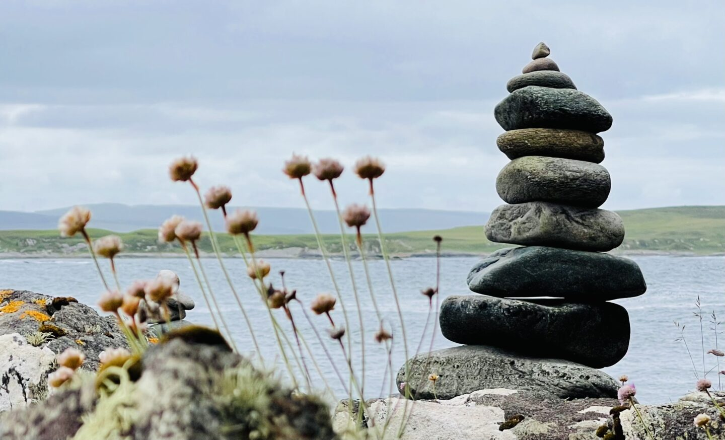 rocks stacked up with the sea behind