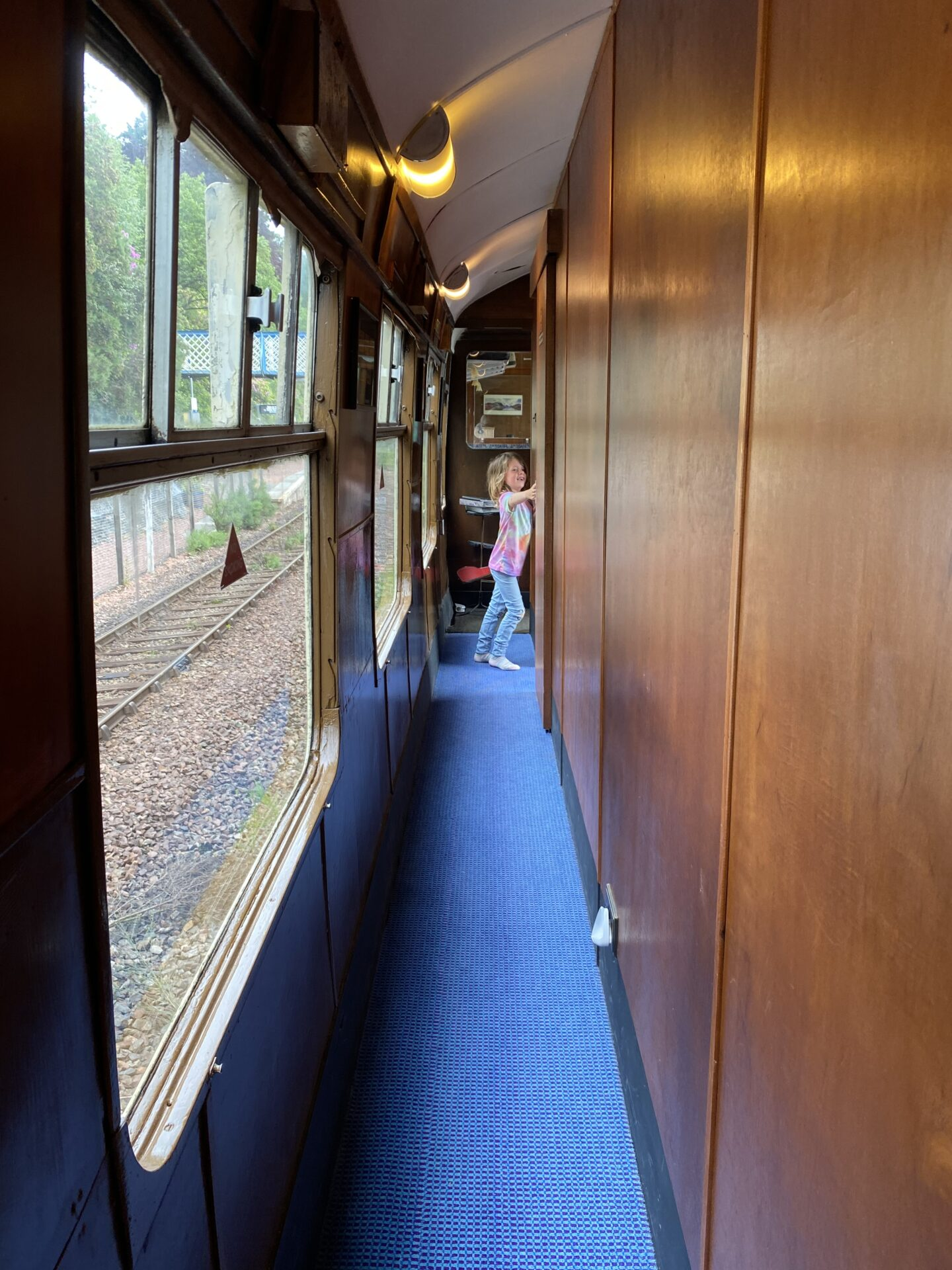 child in old railway carriage