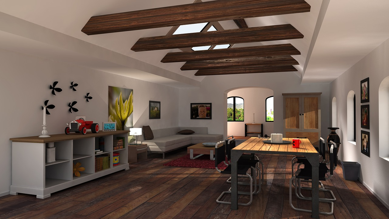 living area with white walls and kitchen table