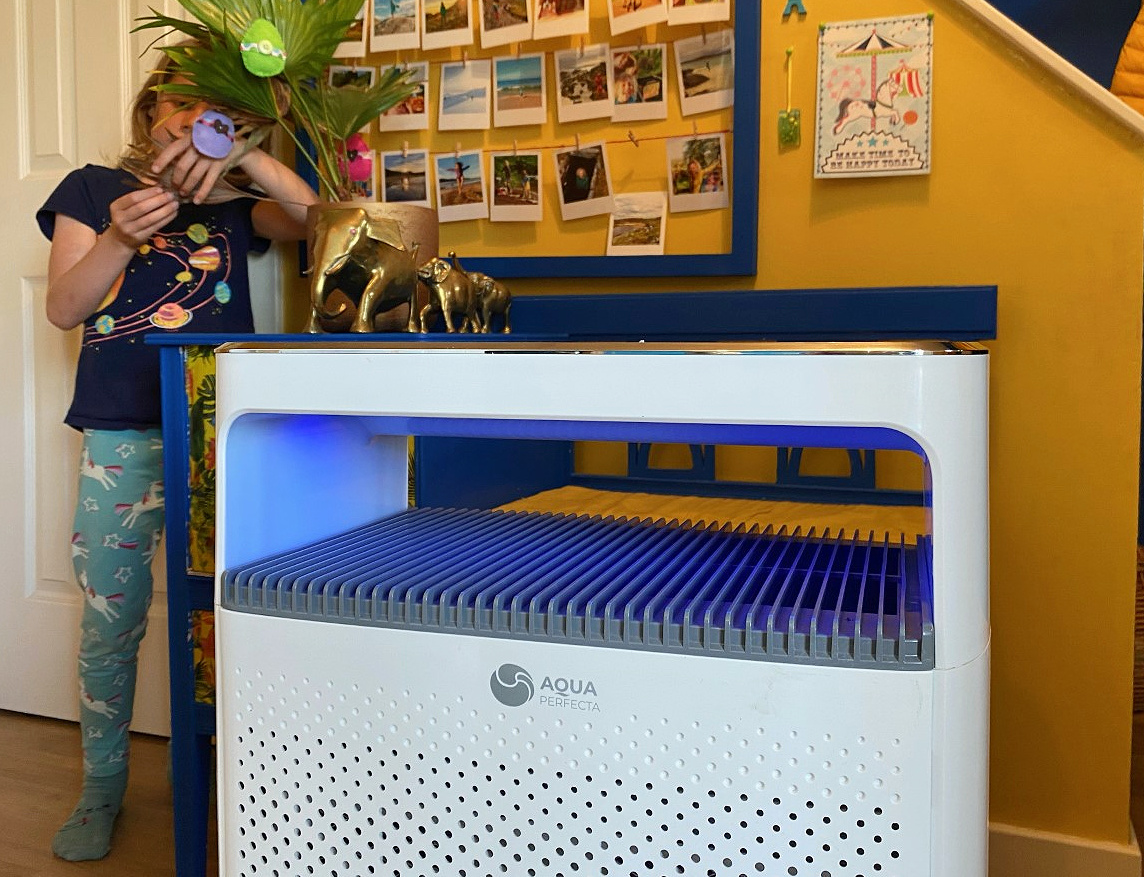 Air purifier with light on showing air quality